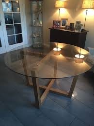 next large round glass and solid oak dining table excellent condition