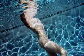 Nude swimming underwater woman
