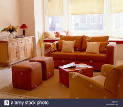 Terracotta Living Room Modern Livingroom With Terracotta Sofa And Upholstered Stools And