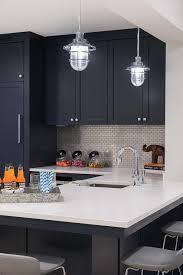 dark blue shaker bar cabinets with mini brick tiles