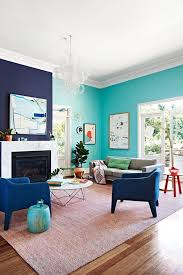 Navy Blue Accent Wall Color With Teal Paint Color For Relaxing Family Room  Ideas Using Two Colors Combination With Chic Round Shaped Coffee Table