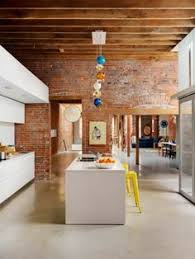 the interior design is exposed brickwork ceilings with wooden beams and concrete floors designed by architect omer arbel talented photographer martin architect omer arbel office click