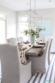 neutral coastal dining room with a blush pink toned valentine s day tablescape valentinesday