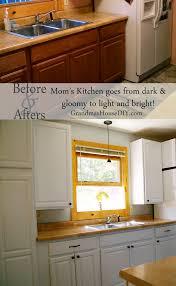 diy paint kitchen cabinetsPainting kitchen cabinets taking my moms dark kitchen into light