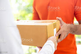 Courier Service Delivery Man Giving Parcel Box To Customer Stock Photo -  Download Image Now - iStock