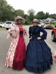 the newest member of louisa dar deanna muncy left posed with regent sabrina may for a pic in their colonial garbs which helped dar win first place float