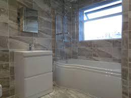 p shaped shower bath bathroom mirror and grey bathroom tiles
