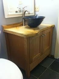 custom made cherry bathroom vanity with live edge pine counter