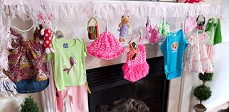 Use Command Clear Mini Hooks to hang the clothesline and items from your  mantle.