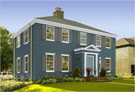 house with teal exterior paint