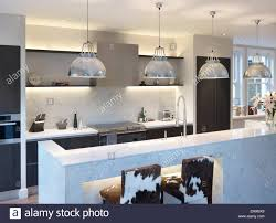 kitchen pendant lighting over island. Pendant Lighting Above Island Unit In Large Modern Kitchen And Over E