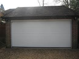 Hormann White M Ribbed Woodgrain Sectional Garage Door Hormann ...