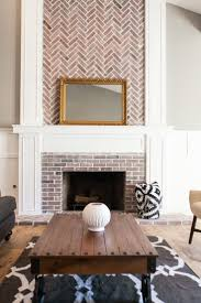 Custom fireplace with herringbone brick work - by Rafterhouse. I would  prefer the brick color to match (fireplace area and above) but the  herringbone ...
