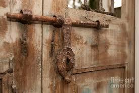 antique photograph old iron door latch on wooden door by will deni mcintyre