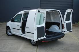 the caddy has one sliding door on the left hand side and twin swing