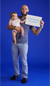 Image Application Man Holding Baby While Holding Paper Sign Pier Careers At Pier Imports