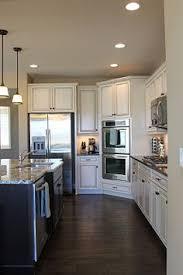 dark hardwood floors kitchen. Delighful Kitchen Dark Wood Floors With Off White Cabinets Black Appliance  Google Search To Dark Hardwood Floors Kitchen T