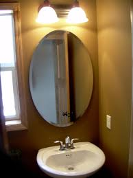 bathroom lighting and mirrors. Excellent Oval Bathroom Mirrors With 2 Light Fixtures And Standalone White Sink For Modern Vanity Lighting R