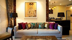 decoration: Elegant Living Room Asian Designs With Sofa Also Cushions  Between Small Dressers Including Black