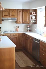 ideas to update oak kitchen or bathroom cabinets without paint including hardware and decor