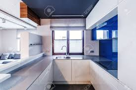Window In Modern White And Blue Kitchen Interior With Glossy