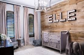 neutral rustic nursery with pine accent wall
