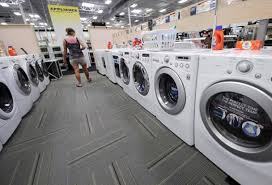 row of washing machines. Delighful Row The Raid Comes Amid An Increasingly Bitter Rivalry Between The Two  Companies Which Compete In Home On Row Of Washing Machines H