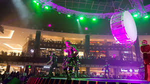 qatar at the heart of the mall of qatar is a 360 theatre with acts of all kinds taking place on a multi lift rotating stage the lighting design around