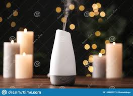 Aroma Space Design Modern Aroma Humidifier With Candles On Table Against