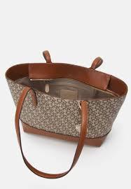 DKNY POLLY SUTTON - Handbag - chino/caramel/light brown - Zalando.co.uk