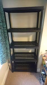 two heavy duty black plastic storage shelves from b q