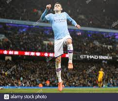 Manchester City's Phil Foden celebrates scoring his side's fourth goal of  the game during the FA Cup third round match at the Etihad Stadium,  Manchester Stock Photo - Alamy