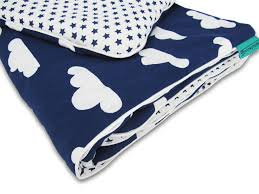 reversible nursery bedding set white clouds navy stars