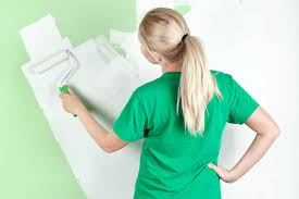 best tools to help you pick out paint colors for your walls woman painting wall roller