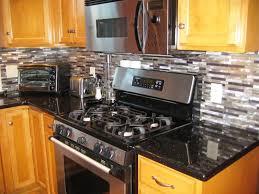 golden oak cabinets and countertops black granite