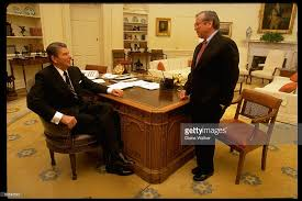 filethe reagan library oval office. president ronald reagan sitting at desk speaking to white house chief of staff howard baker filethe library oval office e