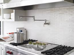 pot filler faucet for efficient use of space white tile back splash with wall mount