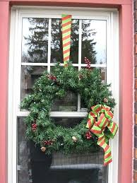 large outdoor lighted wreaths hang wreaths on windows