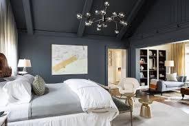 Dark Gray and Gold Bedroom with Vaulted Ceiling