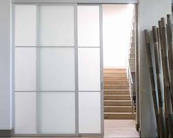 sliding door system featuring dn80 sliding hardware af003 frame in natural aluminum finish and satin glass inserts with divider rails