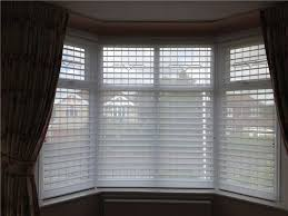 Dressing A Bay Window By Combining Curtains And Roller Blinds Bay Window Blind Ideas