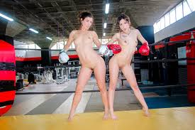 Exciting public lesbian sex in the boxing ring with oiled up.