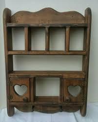 vintage wooden curio cabinet heart rack