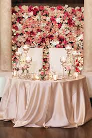 flower wall for wedding wall of flowers behind sweetheart table photography by