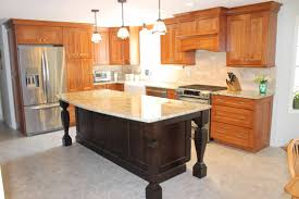traditional kitchen with large center island granite state cabinetry
