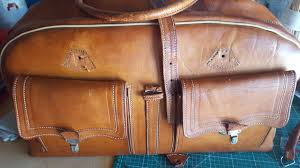 this was a 1960 weekender bag in need of repair patterns were made of the damaged parts