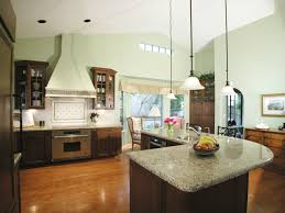 sleek kitchen design idea with high ceiling also brown cabinetry with  granite top also l shaped