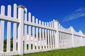 white picket fence. A View From The Bottom Of Fence, Looking Up At Blue Sky. White Picket Fence E