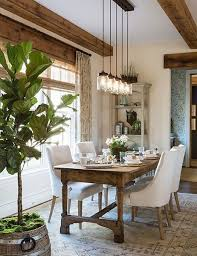 dining room decor ideas rust farmhouse style with natural wood table and beams and upholstered white chairs