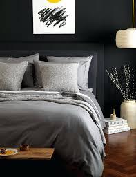 bed linen dark grey linen duvet cover light grey duvet cover wooden floor pot with
